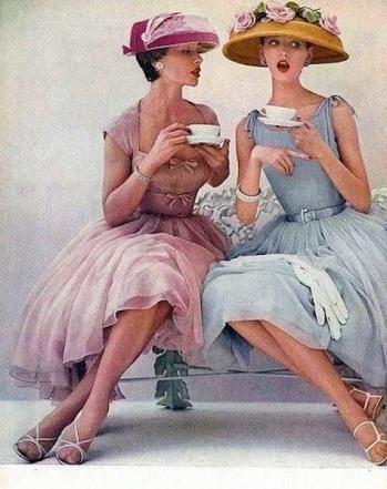 vintage-women-drinking-tea-in-nice-dresses