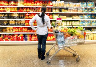8007505-Young-woman-with-shopping-cart-in-the-supermarket-when-shopping--Stock-Photo.jpg